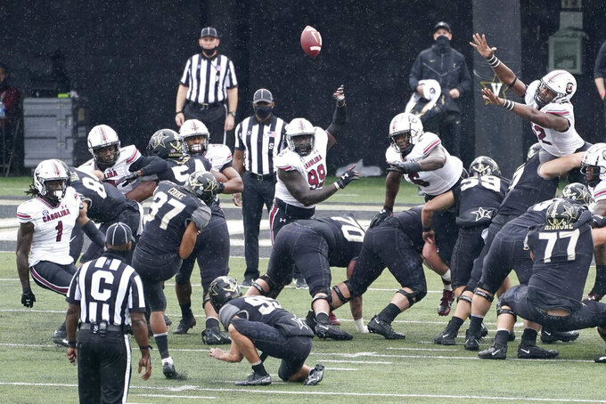 Vanderbilt kicker Pierson Cooke (37) kicks wide of the goalpost as he misses a 29-yard field goal attempt against South Carolina in the first half of an NCAA college football game Saturday, Oct. 10, 2020, in Nashville, Tenn. (AP Photo/Mark Humphrey)