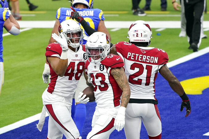Arizona Cardinals cornerback Byron Murphy (33) celebrates his fumble recovery with linebacker Isaiah Simmons (48) and cornerback Patrick Peterson (21) during the first half of an NFL football game Sunday, Jan. 3, 2021, in Inglewood, Calif. (AP Photo/Ashley Landis)