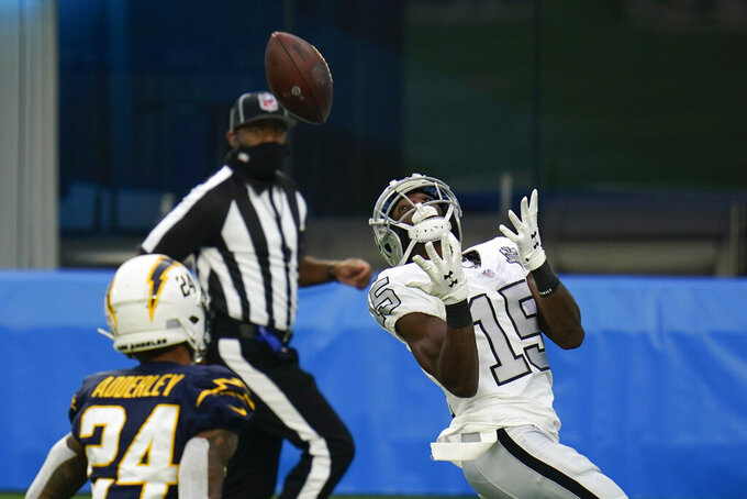 Las Vegas Raiders wide receiver Nelson Agholor makes a catch on his way to scoring a touchdown during the second half of an NFL football game against the Los Angeles Chargers. Sunday, Nov. 8, 2020, in Inglewood, Calif. (AP Photo/Alex Gallardo)