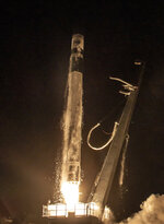 In this remote image provided by Rocket Lab, Monolith, a research and development satellite for the U.S. Space Force is successfully launched into orbit Thursday, July 29, 2021, by an Electron rocket during Rocket Lab's second mission for the Space Force from the Rocket Lab Launch Complex 1, in Mahia, New Zealand. The company said it has now launched 105 satellites. (Rocket Lab via AP)