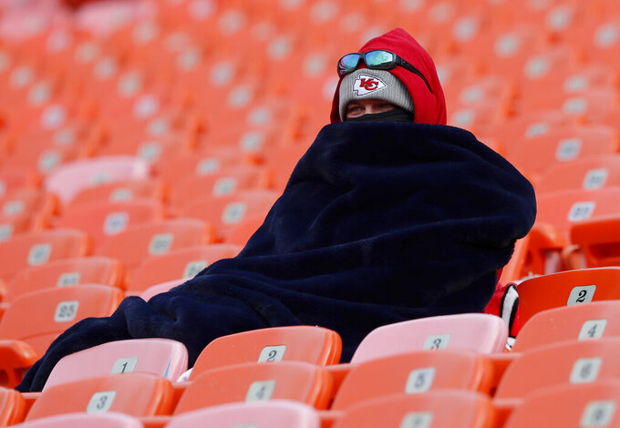 A fan bundles up before the AFC Championship NFL football game between the Kansas City Chiefs and the New England Patriots, Sunday, Jan. 20, 2019, in Kansas City, Mo. (AP Photo/Charlie Neibergall)
