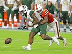 Miami cornerback Al Blades, Jr. (7) defends against UAB's Austin Watkins Jr. (6) during an NCAA college football game in Miami Gardens, Fla., Thursday, Sept. 10, 2020. (Al Diaz/Miami Herald via AP)