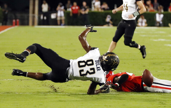 Vanderbilt wide receiver C.J. Bolar (83) fumbles after being hit by Georgia defensive back Richard LeCounte (2) during the second half of an NCAA college football game Saturday, Oct. 6, 2018, in Atlanta, Ga. Vanderbilt recovered. (AP Photo/John Bazemore)