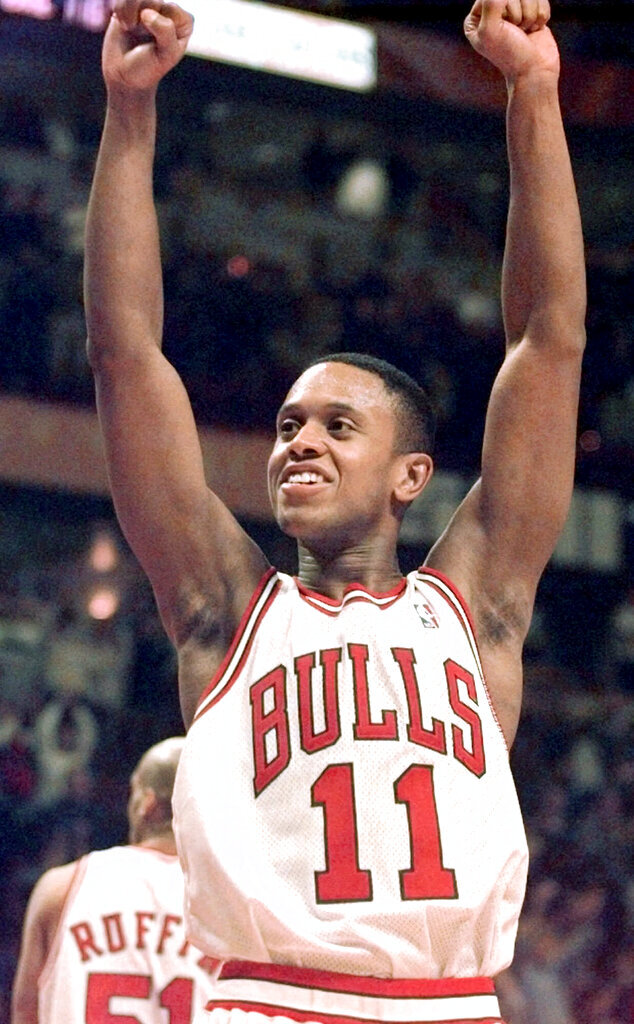 FILE - In this Jan. 5, 2000, file photo, Chicago Bulls' B.J. Armstrong celebrates the Bulls' 77-66 win over the Washington Wizards in Chicago. Armstrong earned three rings with the Chicago Bulls, as part of their NBA championship teams in 1991, 1992 and 1993. (AP Photo/Ted S. Warren,File)