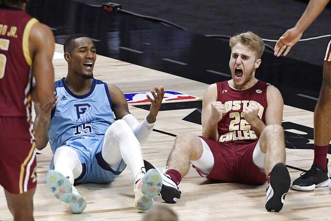 Rhode Island's Jalen Carey, left, and Boston College's Rich Kelly, right, react to a foul called against Carey during the second half of an NCAA college basketball game Thursday, Nov. 26, 2020, in Uncasville, Conn. (AP Photo/Jessica Hill)