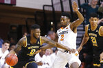 Wichita State guard Jamarius Burton (2) drives around Oklahoma State guard Chris Harris Jr. (2) in the first half of an NCAA college basketball game in Stillwater, Okla., Sunday, Dec. 8, 2019. (AP Photo/Sue Ogrocki)
