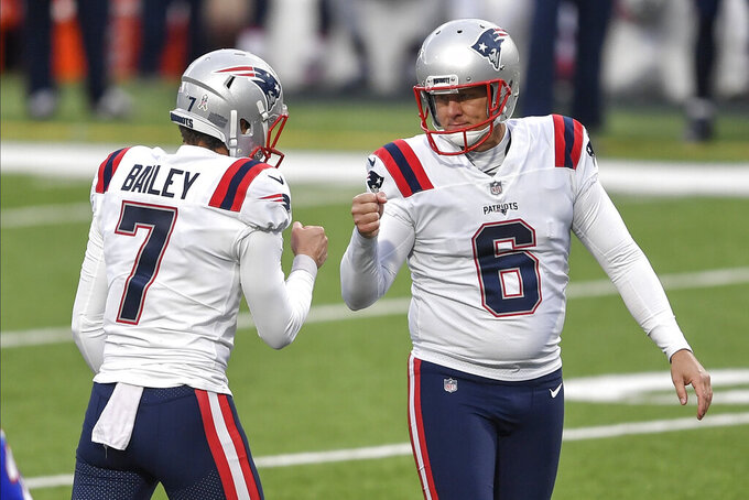 New England Patriots' Nick Folk (6) celebrates with Jake Bailey (7) after kicking a field goal during the first half of an NFL football game against the Buffalo Bills Sunday, Nov. 1, 2020, in Orchard Park, N.Y. (AP Photo/Adrian Kraus)