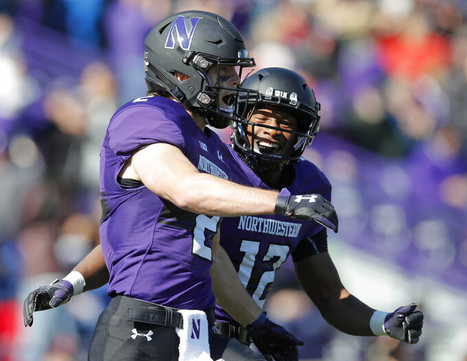 Northwestern's Flynn Nagel, left, celebrates his touchdown against Nebraska with teammate JJ Jefferson during the first half of an NCAA college football game Saturday, Oct. 13, 2018, in Evanston, Ill. (AP Photo/Jim Young)