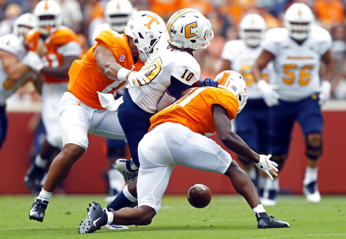 Chattanooga wide receiver Lameric Tucker (10) fumbles the ball as he's hit by Tennessee defensive back Kenneth George Jr. (41) and linebacker Henry To'o To'o (11) in the first half of an NCAA college football game Saturday, Sept. 14, 2019, in Knoxville, Tenn. (AP Photo/Wade Payne)