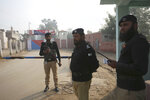 Pakistani police officers stand guard outside Multan jail after a court's decision for a professor facing blasphemy case, in Multan, Pakistan, Saturday, Dec. 21, 2019. A Pakistani court on Saturday convicted the Muslim professor of blasphemy, sentencing him to death for allegedly spreading anti-Islamic ideas. Junaid Hafeez has been held for six years awaiting trial. He's spent most of that time in solitary confinement because he would likely be killed if left with the general population, local media have reported. (AP Photo/Asim Tanveer)