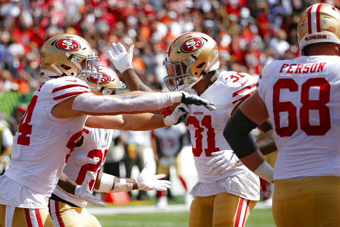San Francisco 49ers running back Raheem Mostert (31) celebrates his touchdown during the first half an NFL football game against the Cincinnati Bengals, Sunday, Sept. 15, 2019, in Cincinnati. (AP Photo/Frank Victores)