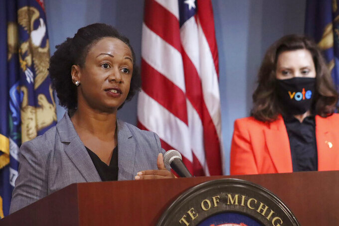 FILE- In a July 28, 2020 file photo, provided by the Michigan Office of the Governor, Dr. Joneigh Khaldun, the state's chief medical executive, addresses the state during a speech in Lansing, Mich. Dr. Khaldun, Michigan's chief medical executive and a top pandemic adviser to Gov. Gretchen Whitmer, is leaving state government for a new job.(Michigan Office of the Governor via AP, File)