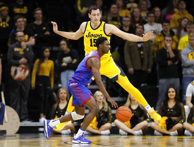 DePaul guard Jalen Coleman-Lands drives past Iowa forward Ryan Kriener, rear, during the second half of an NCAA college basketball game, Monday, Nov. 11, 2019, in Iowa City, Iowa. DePaul won 93-78. (AP Photo/Charlie Neibergall)