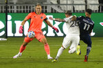 Inter Miami goalkeeper Luis Robles, left makes a save as Leandro Gonzales Pirez (26) defends against New York City FC midfielder Valentin Castellanos (11) during the first half of an MLS soccer match, Saturday, Oct. 3, 2020, in Fort Lauderdale, Fla. (AP Photo/Lynne Sladky)