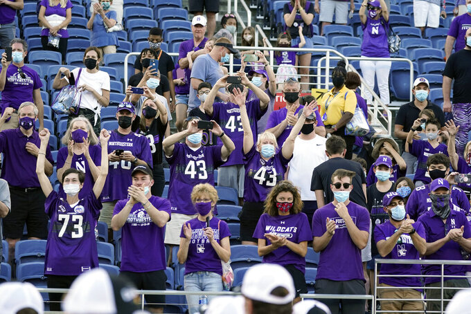 Northwestern fans cheer the players after they defeated Auburn 35-19 in the Citrus Bowl NCAA college football game, Friday, Jan. 1, 2021, in Orlando, Fla. (AP Photo/John Raoux)
