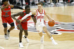 Ohio State's Jimmy Sotos, right, tries to dribble past Illinois State's Abdou Ndiaye during the second half of an NCAA college basketball game Wednesday, Nov. 25, 2020, in Columbus, Ohio. Ohio State beat Illinois State 94-67. (AP Photo/Jay LaPrete)