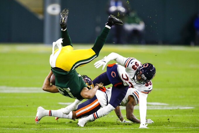 Green Bay Packers' Allen Lazard is flipped after catcing a pass during the first half of an NFL football game against the Chicago Bears Sunday, Nov. 29, 2020, in Green Bay, Wis. (AP Photo/Matt Ludtke)