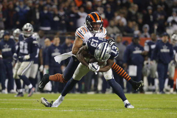 Dallas Cowboys' Michael Gallup (13) is tackled by Chicago Bears' Kevin Toliver as his shoe comes off during the second half of an NFL football game, Thursday, Dec. 5, 2019, in Chicago. (AP Photo/Morry Gash)