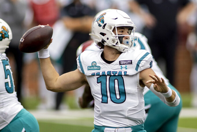 FILE - In this Dec. 12, 2020, file photo, Coastal Carolina quarterback Grayson McCall (10) throws against Troy during an NCAA college football game in Troy, Ala. The Chanticleers host Kansas Friday night and have won 12 of their past 13 games. (AP Photo/Vasha Hunt, File)