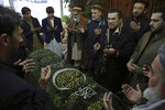 Afghan politicians pray over the coffin of Afghan former president, Sibghatullah Mujadidi, at his house in Kabul, Afghanistan, Tuesday, Feb. 12, 2019. Mujadidi, who was Afghanistan's first president following the withdrawal of the Soviet army and the collapse in 1992 of Kabul's pro-communist government, has died at 93. During the 10-year invasion by the Soviets, Mujadidi led perhaps the smallest and most moderate of the guerrilla groups, backed by the United States. Following the collapse of the communist government, he served for two months as Afghanistan's president. (AP Photo/Rahmat Gul)