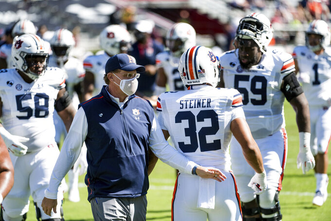 Auburn head coach Gus Malzahn walks across the field during halftime of an NCAA college football game against South Carolina, Saturday, Oct. 17, 2020, in Columbia, S.C. (AP Photo/Sean Rayford)