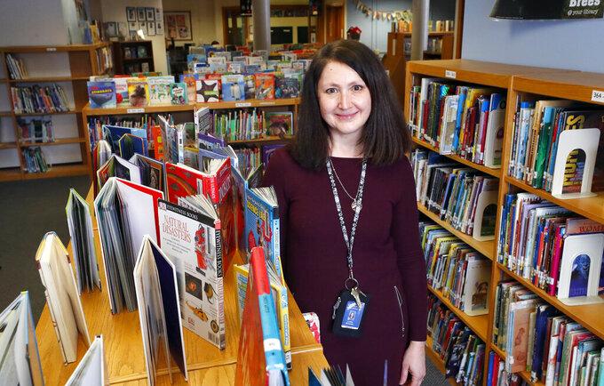 Emerson Elementary School librarian Lauren Blanford Wednesday Feb. 24, 2021 in Elmhurst, Ill. (Brian Hill/Daily Herald via AP)