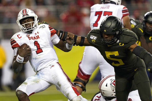 FILE - In this Dec. 6, 2018, file photo, Utah quarterback Tyler Huntley (1) is sacked by Oregon defensive end Kayvon Thibodeaux (5) during the second half of an NCAA college football game for the Pac-12 Conference championship in Santa Clara, Calif. Thibodeaux was selected to The Associated Press preseason All-America first-team, Tuesday, Aug. 25, 2020. (AP Photo/Tony Avelar)