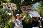 Supporters of mask mandates in public schools gather outside the Governor's Mansion in Austin, Texas, Monday, Aug. 23, 2021. (AP Photo/Eric Gay)