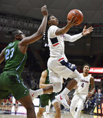 Connecticut's Alterique Gilbert (3) goes up to the basket as Tulane's Blake Paul defends during the first half of an NCAA college basketball game, Saturday, Jan. 19, 2019, in Storrs, Conn. (AP Photo/Jessica Hill)