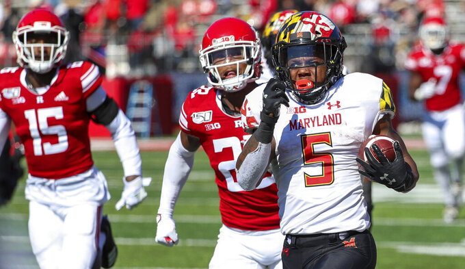 Maryland running back Anthony McFarland Jr. (5) carries the ball for an 80-yard touchdown run against Rutgers during the third quarter of an NCAA college football game, Saturday Oct. 5, 2019, in Piscataway, N.J. (Andrew Mills/NJ Advance Media via AP)
