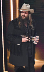 Chris Stapleton accepts the award for single of the year for