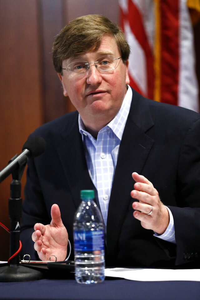 Gov. Tate Reeves stresses the need for personal responsibility in wearing face masks during his opening statement at a coronavirus news briefing, Wednesday, July 8, 2020 in Jackson, Miss. (AP Photo/Rogelio V. Solis)