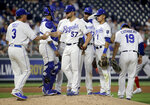 Kansas City Royals manager Ned Yost (3) takes the ball from starting pitcher Glenn Sparkman (57) as he makes a pitching change during the sixth inning of a baseball game against the Boston Red Sox Tuesday, June 4, 2019, in Kansas City, Mo. (AP Photo/Charlie Riedel)