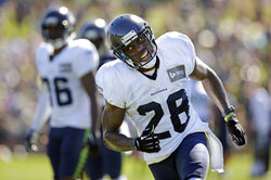 FILE - In this July 30, 2014 file photo, Seattle Seahawks' Phillip Adams runs during an NFL football camp practice in Renton, Wash. A source briefed on a mass killing in South Carolina says the gunman who killed multiple people, including a prominent doctor, was the former NFL pro. The source said that Adams shot himself to death early Thursday, April 8, 2021. (AP Photo/Elaine Thompson, File)