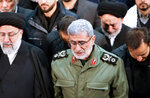 In this photo released by the official website of the Office of the Iranian Supreme Leader, Gen. Esmail Ghaani, newly appointed commander of Iran's Revolutionary Guards Quds Force, weeps while praying over the coffin of the force's previous head Gen. Qassem Soleimani at the Tehran University Campus in Tehran, Iran, Monday, Jan. 6, 2020. Soleimani was killed Friday, Jan. 3 in a U.S. drone attack in Iraq. (Office of the Iranian Supreme Leader via AP)