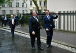 US Secretary of State Mike Pompeo is greeted by Britain's Foreign Secretary Jeremy Hunt, right, in central London, Wednesday May 8, 2019. U.S. Secretary of State Mike Pompeo is in London for talks with British officials on the status of the special relationship between the nations amid heightened tensions with Iran and uncertainty over Britain's exit from the European Union. (Mandel Ngan/Pool via AP)