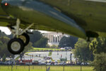 """The Jefferson Memorial is visible behind White flags near the Washington Monument on the National Mall as Marine One with President Joe Biden abroad lands at the White House in Washington, Monday, Sept. 20, 2021, after returning from Rehoboth Beach, Del. The flags, which number more than 630,000, are part of artist Suzanne Brennan Firstenberg's temporary art installation, """"In America: Remember,"""" in remembrance of Americans who have died of COVID-19. (AP Photo/Andrew Harnik)"""
