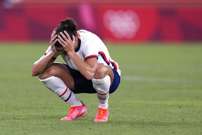 United States' Carli Lloyd reacts after being defeated 1-0 by Canada during a women's semifinal soccer match at the 2020 Summer Olympics, Monday, Aug. 2, 2021, in Kashima, Japan.. (AP Photo/Fernando Vergara)