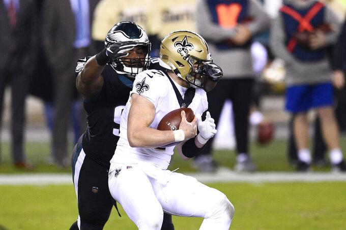 Philadelphia Eagles' Javon Hargrave, left, sacks New Orleans Saints' Taysom Hill during the first half of an NFL football game, Sunday, Dec. 13, 2020, in Philadelphia. (AP Photo/Derik Hamilton)