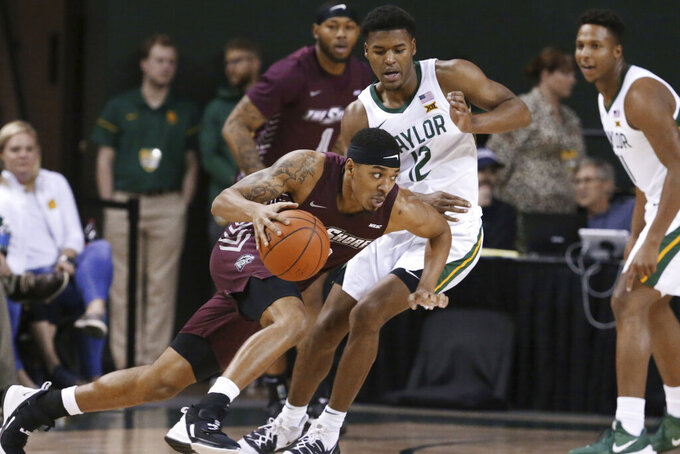 Maryland-Eastern Shore guard Ty Gibson, left, drives around Baylor guard Jared Butler, right, in the first half of an NCAA college basketball game, Tuesday, Dec. 3, 2019, in Waco, Texas. (AP Photo/Rod Aydelotte)