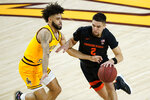 Oregon State guard Jarod Lucas (2) drives as Arizona State guard Holland Woods defends during the first half of an NCAA College basketball game, Sunday, Feb. 14, 2021, in Tempe, Ariz. (AP Photo/Matt York)