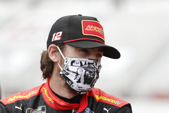 FILE  - This June 7, 2020, file photo shows Ryan Blaney waiting in pit row before a NASCAR Cup Series auto race at Atlanta Motor Speedway in Hampton, Ga. With a bit of disbelief over his fast fall in NASCAR's standings, Ryan Blaney is determined to avoid elimination from the playoffs. (AP Photo/Brynn Anderson, File)