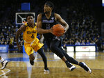 Buffalo guard CJ Massinburg (5) drives past Kent State guard Antonio Williams (4) during the second half of an NCAA college basketball game, Friday, Feb. 22, 2019, in Buffalo, N.Y. (AP Photo/Jeffrey T. Barnes)