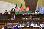 Afghan President Ashraf Ghani, second left, speaks at the extraordinary meeting of the Parliament in Kabul, Afghanistan, Monday, Aug. 2, 2021. (AP Photo/Rahmat Gul)