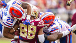 Florida defensive back Jeawon Taylor (29) and linebacker David Reese II (33) stop Florida State wide receiver Tre'Shaun Harrison (88) in the second half of an NCAA college football game in Tallahassee, Fla., Saturday, Nov. 24, 2018. Florida defeated Florida State 41-14. (AP Photo/Mark Wallheiser)