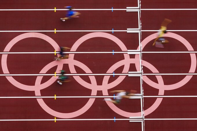 Runners competes during the first round of the men's 400-meter hurdles at the 2020 Summer Olympics, Friday, July 30, 2021, in Tokyo. (AP Photo/Morry Gash)
