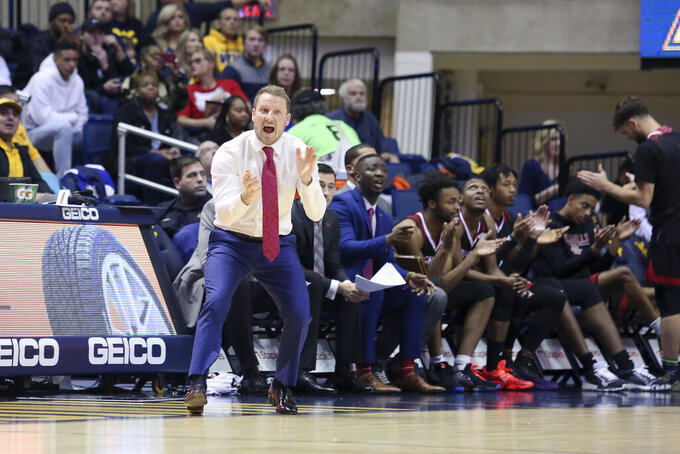 Nicholls State coach Austin Claunch reacts from the side during the second half of an NCAA college basketball game against West Virginia Saturday, Dec. 14, 2019, in Morgantown, W.Va. (AP Photo/Kathleen Batten)