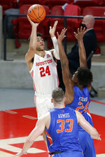 Houston guard Quentin Grimes (24) puts up a shot over Boise State forward Abu Kigab (24) and forward Mladen Armus (33) during the first half of an NCAA college basketball game Friday, Nov. 27, 2020, in Houston. (AP Photo/Michael Wyke)
