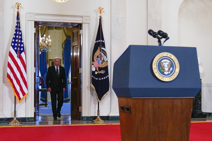 President Joe Biden arrives to speak about a cease-fire between Israel and Hamas, in the Cross Hall of the White House, Thursday, May 20, 2021, in Washington. (AP Photo/Evan Vucci)