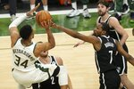 Milwaukee Bucks' Giannis Antetokounmpo shoots over Brooklyn Nets' Kevin Durant during the first half of Game 4 of the NBA Eastern Conference basketball semifinals game Sunday, June 13, 2021, in Milwaukee. (AP Photo/Morry Gash)